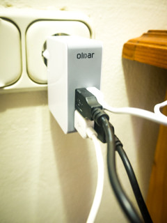 olixar-travel-adapter-with-4-usb-ports-plugged-into-wall